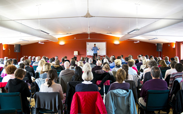 Serge Benhayon on stage at the Universal Medicine UK Retreat 2013